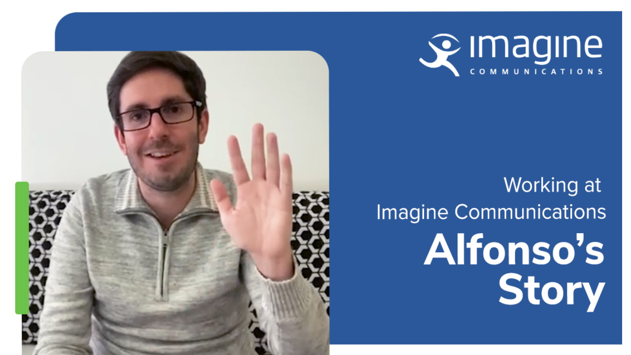 Man wearing glasses waving at the screen