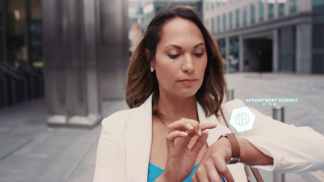 Business woman using smart watch to check calendar