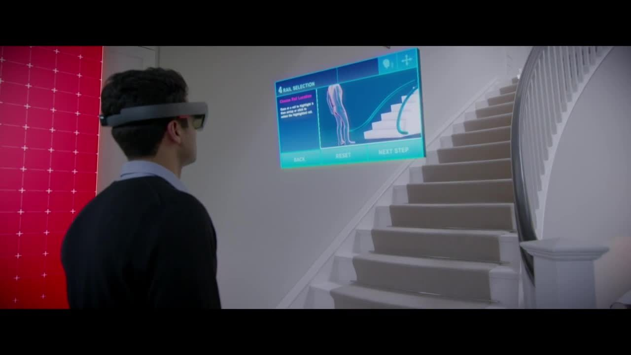 man wearing hololens looking at staircase