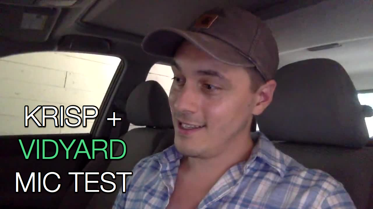 A man in a car doing a Krips and Vidyard microphone test.