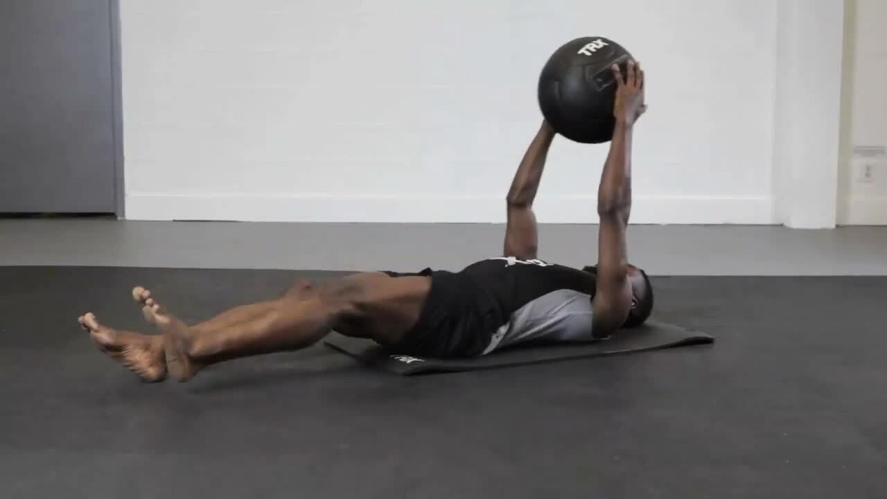 TRX_Med Ball_Supine Alternating Knee Strikes_Male