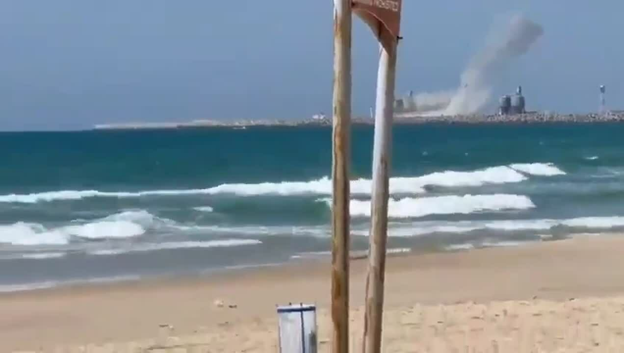 Rockets landing near ship at sea
