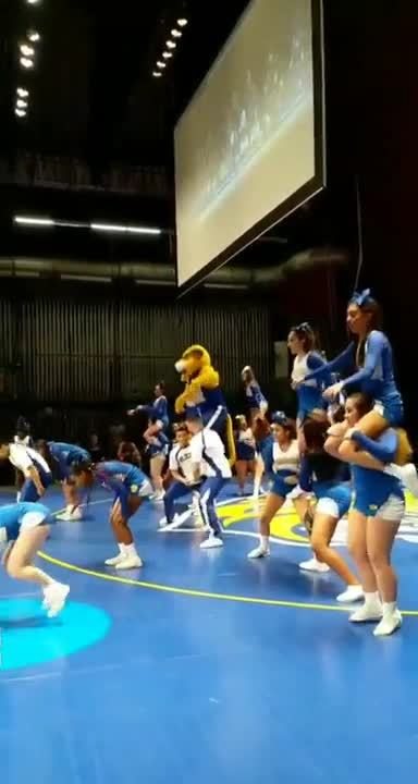 The JWU Cheer Squad cheers on the home team