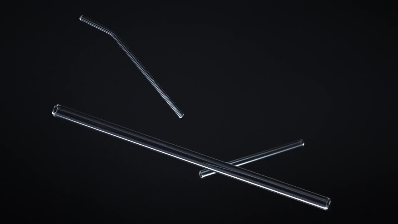 Falling-glass-straws-black-background
