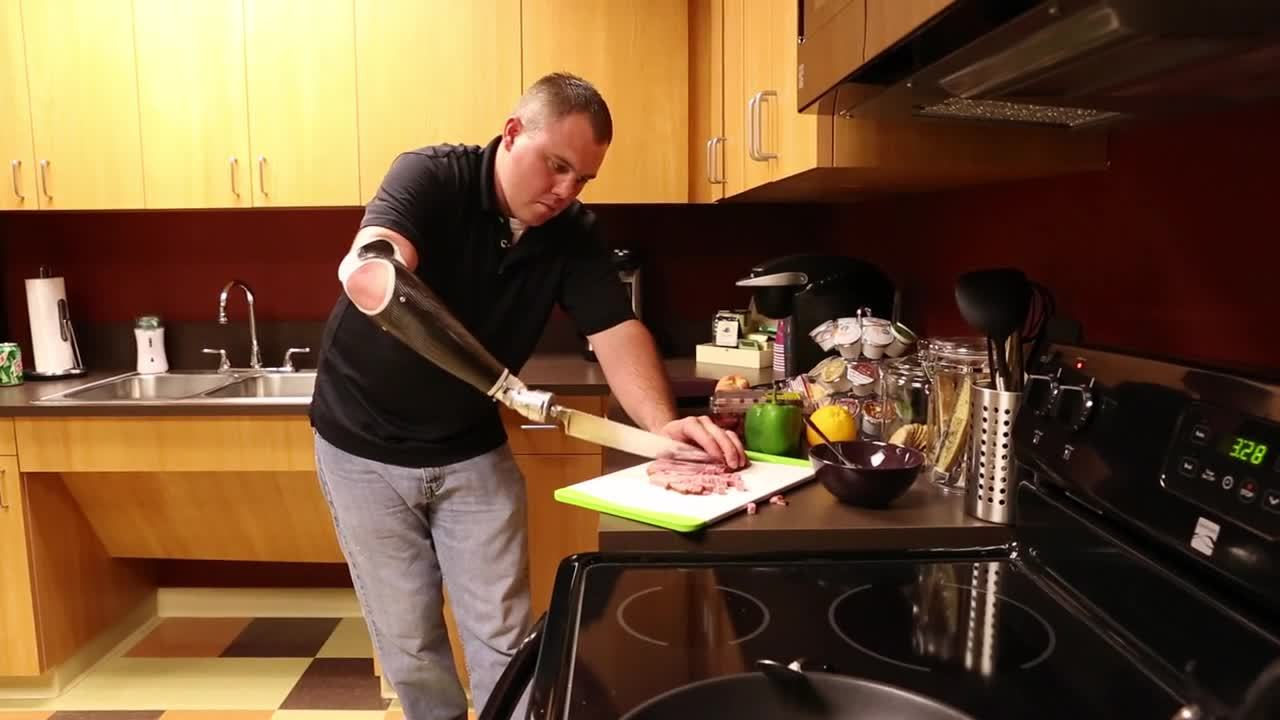 Jon Fontaine Cooking with Midwest ProCAD four-way locking wrist and knife attachment